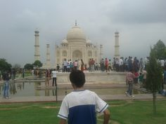 The boy inspecting India and The Taj Mahal.