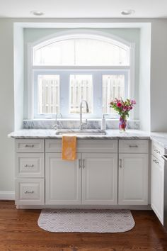 White Kitchen with Arched Window by Design Manifest- White Marble Countertops