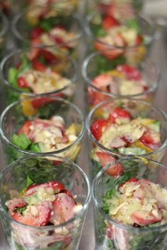 salad in a cup.  Great wedding cocktail hour food.  More or less a small bar glass with a few pieces of lettuce, some dressing, and a few color foods with a toothpick in the middle!  Great idea