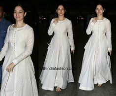 Tamanna Bhatia in a white floor length anarkali is part of White anarkali - Tamanna Bhatia was spotted at the airport in a white anarkali Indian Gowns, Indian Attire, Pakistani Dresses, Indian Outfits, Indian Wear, Kurta Designs Women, Salwar Designs, Saree Blouse Designs, Dress Designs