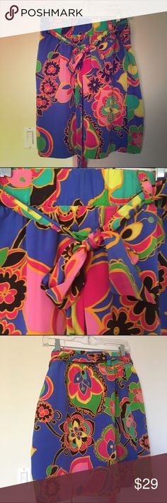 Silk I multi color Lilly Pulitzer midi skirt sz M Elastic think waist wide bow going around to be tied mode length straight great pre owned condition no flaws Lilly colors gray for holidays silk made elegant skirt waist 30 not stretched Lilly Pulitzer Skirts Midi