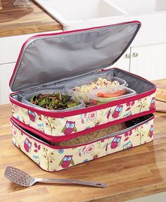 Tote your contribution to a potluck in this Expandable Hot/Cold Food Carrier and ensure it arrives at the proper serving temperature. The base level features an insulating