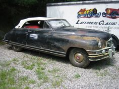 1949 Packard convertible.  BEAUTIFUL!!    1949 was a very good year!  Please don't restore this - love the patina.