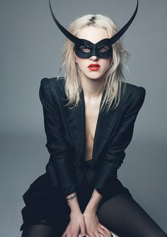 Harriet Verney wearing mask by Philip Treacy, a jacket from the Alexander McQueen archives and tights by Wolford