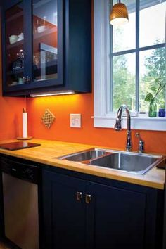 The Tumbleweed Harbinger kitchen.  I like the orange walls with the blue cabinetry