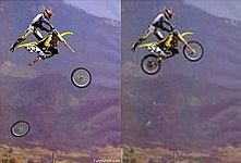 Fake - Loses the wheels in midair. - The original image is on the right. I know that a few wheels have been lost now and then but this ain't one of those times......