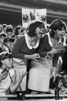 15 Aug 1965, Queens, New York City, New York, USA — Beatles fans scream at the top of their lungs during a concert at Shea Stadium.