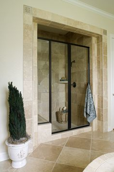 Spacious shower with great tile all around. They have black-framed shower doors and a bench for a more comfortable showering experience. Click on the image to see 7 shower accessories you have to see! #baths #showerbench