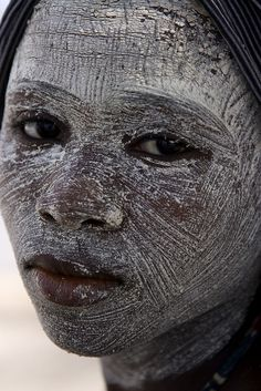 Africa | Woman with a Musiro facemask. Mozambique, Ibo Island. | © Daniele ~ marghe00 musiro facemask