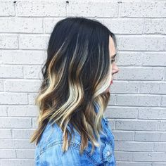 The high contrast between dark brunette and bright golden blonde in this ombre by Pavo Salon/Spa is unexpected and inspiring. #AvedaColor formula in comments.