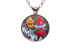 Digital Art Macys Thanksgiving Day Parade Necklace Or Keychain. With this listing you will receive a glass dome pendant and necklace with lobster clasp in organza bag shipped via U.S. mail with tracking number. Package is ready for gift giving. Matching key chains are also available with this design. For key chain choice select your pendant choice and then under necklace options you will select key chain. Four Pendant Choices Available: ANTIQUE SILVER ANTIQUE COPPER ANTIQUE BRONZE GUN…