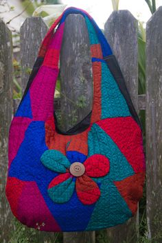 Beautiful handmade patchwork shoulder bags with front flower detail.