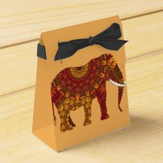 An unusual personalized wedding party favor box with a beautiful ornate patterned Indian elephant in red orange and golden yellow tones. Just change the text to suit your personal needs, at no extra cost. Click on the image below for more items from this Wedding set Indian Elephant And Henna Hands Wedding Designs by Fliss
