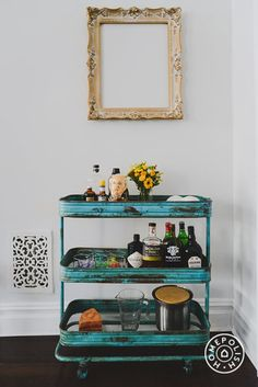 Classic Goes Eclectic - love the gilded mirror above the bar cart.