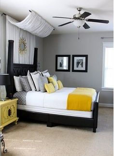 A masculine room with a soft draped bed canopy = a more unisex bedroom.