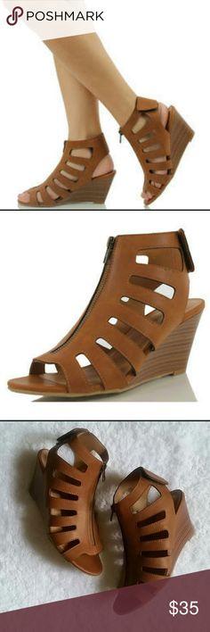 Wedge Sandals Never worn. Zipper at center snaps around heel. Heel height 3 inches Shoes Wedges