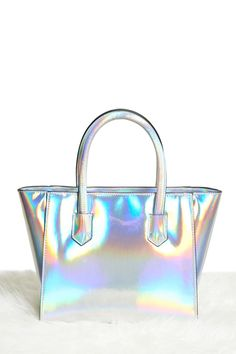 A structured satchel featuring an iridescent sheen, top handles, a top zip, and two interior pockets.