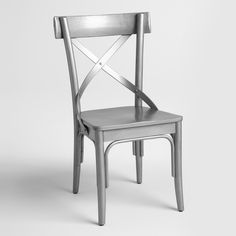 """Our affordable vintage-inspired side chairs are reminiscent of Parisian patisserie seating. Crafted of distressed acacia wood and rattan, each features swooping """"X"""" detailing and a wide, flat seat."""