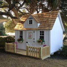 interior-exterior-awesome-white-wood-glass-small-design-playhouses-for-kids-white-wall-and-brown-natural-fence-wall-flower-single-door-skylight-pink-chairs- ...