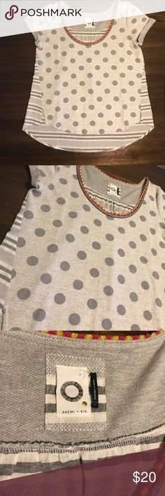 """Anthropologie L Tipperary Tee Anthropologie L Tipperary Tee Top Akemi + Kin Polka Dot Stripe Gray Terry Knit . 60% cotton 40%polyester,body 100% cotton.  Bust 40"""".Sleeves 5"""" . Length : 20"""" front . Back 24.5"""" pre -owned in good condition . Anthropologie Tops Muscle Tees"""