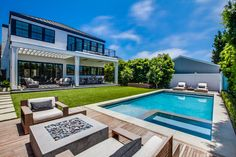 Completed in 2015, this 5-bedroom custom built Federalist inspired home boasts a transitional style combined with modern luxury finishes to satisfy any entertainer's needs. A carefully crafted open floorplan leads to the resort style grounds featuring a lavish BBQ center, swimming pool and spa. The clean lined exterior materials include white brick base, cement plaster second level, and a standing seam metal roof. The entrance space is highlighted by a grand staircase with a large skylight…