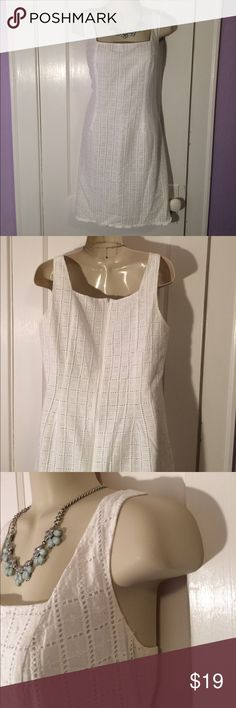 White Eyelet Dress Fully lined, super cute, white, Eyelet dress. Lining is 100% acetate and body is 100% cotton, so it is super cool even during the hottest months. Sight discoloration around the armpits and on the inside of the neck. Bust is approx 20 inches, straps are 6 inches. From armpit to hem the dress is approx 26.5 inches long. Size 12, however I think it's around an 8 or 10. Nine West Dresses Mini