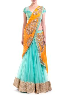 Featuring a blue net lehenga with an intricately embroidered orange attached dupatta embellished with zardosi motifs.  Paired with a hand embroidered stylish blouse.  Length of the lehenga in picture 42 Length of top 15.  Fabric Specificaton Net Lycra raw silk and taffeta.  Slight variation in color is possible.   95% of our customers believe that the product is as shown on the website.