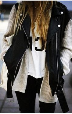with graphic tee, chunky beige cardigan, and biker vest -- perfection.