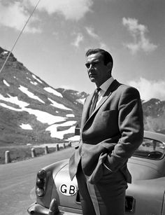 Sean Connery as James Bond next to an Aston Martin DB5. 'Nuff Ced!