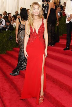 Gigi Hadid in a sexy low-cut red Diane von Furstenberg gown and strappy heels: love the shoes!