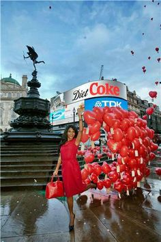 Sinitta looks gorgeous carrying a red Hepburn Bag to launch Love London Day on behalf of the London Lifestyle Awards