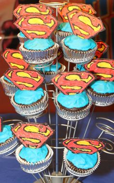 Superman cupcakes with (edible chocolate) shield toppers!