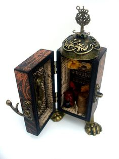 The inside of the Steampunk Spells booth of potions and charms by Nichola using Metal Staples #graphic45 #alteredart