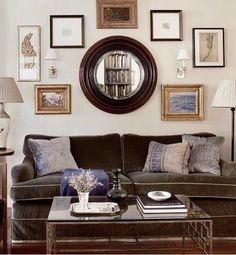 Wall gallery over couch with large round mirror