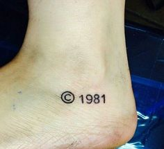 Here's a very simple foot tattoo with a copyright symbol and the owner's birthday which is 1981.