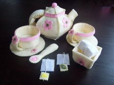 Felt tea party set pattern - $4.50 on Etsy - includes instructions for a teapot with removable lid, teacups and saucers, sugar dish, sugar cubes, teabags, leaf and lemon, and a spoon.