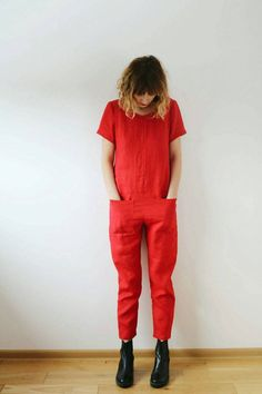 Red linen jumpsuit with short sleeves and front pockets