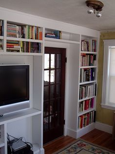 Built-In Shelves - This is exactly what we will add to our front room..  maybe a built in desk too.  might as well while we are at it