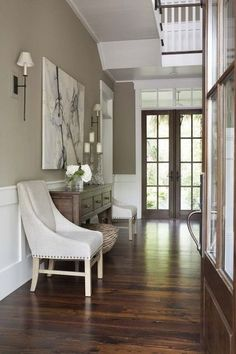 Grayish beige to blend with the windows mulions in the living room but how will it look with the stained trim?   from houzz - beige article  traditional entry by Linda McDougald Design | Postcard from Paris Home