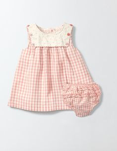 Days strolling along the seaside just got a whole lot sweeter with our sailor dress. It's perfect for popping on over a body when there's a nip in the air. The matching knickers make little tumbles extra adorable, and we've added buttons down the back for easier changing.
