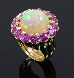 (no description, but this ring looks like a cabochon opal surrounded by amethysts and diamonds.   SPN_Angel)