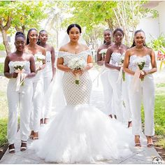 20 Wedding Parties That Prove Bridesmaids' Jumpsuits Are Just as Beautiful as Dresses women wearing white strapless bridesmaids jumpsuits holding white floral bouqets Chic Bridesmaid Dresses, Dessy Bridesmaid, Blue Bridesmaids, Wedding Bridesmaids, Bridesmaid Jumpsuits, Wedding Attire, Wedding Gowns, Wedding Parties, African Wedding Dress