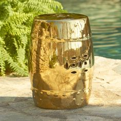 Embossed Dot Garden Stool, Gold | A raised-dot pattern trims the top and bottom of this ceramic garden stool finished in stunning gold. Use it as spare seating or an eye-catching end table.