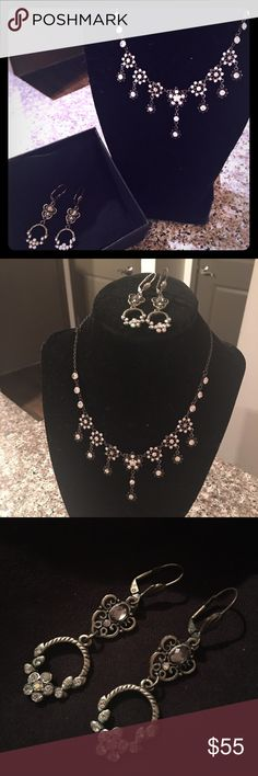 Swarovski crystals necklace + earrings set holiday Gorgeous set of fancy Necklace + Earrings made of clear shiny Swarovski crystals, perfect for any dressy occasion! Holiday Christmas parties, gift set, wedding, or work Christmas party! Worn once to a wedding. Excellent condition, like new! Purchased at Nordstrom in Atlanta. Ships from Atlanta! Swarovski Jewelry Necklaces