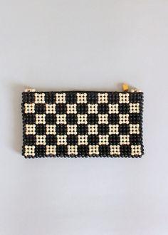 1940s plastic checker board clutch purse with a bakelite zipper pull