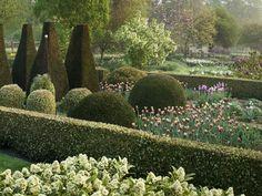 Main topiary walk at Pettifers Garden, Oxfordshire UK