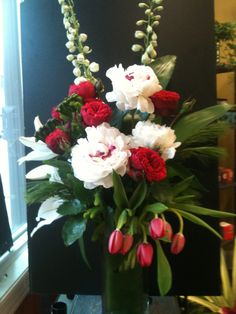 #Holiday. Gorgeous South American #peonies, white delphinium, red tulips and ruby red #garden roses, and I love winter greens hardy and richly fragrant