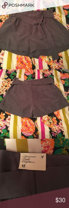American Eagle culottes style shorts (size 12) These shorts have NEVER been worn before!! Light grey color. Tags are still attached. American Eagle Outfitters Shorts