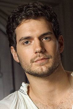 Henry Cavill.  Fun trivia fact: Stephanie Meyer had him in mind as the original face of Edward Cullen.  At 25, he was just a little too old to play an eternally 17 year old vampire.