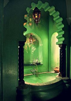 Green glazed plaster lends drama to this Moroccan tub.